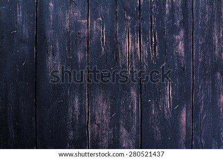 Old shabby wooden planks with cracked color paint, toned image