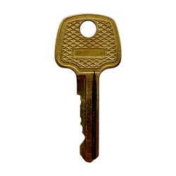 old shabby yellow golden door lock key on a white isolated background