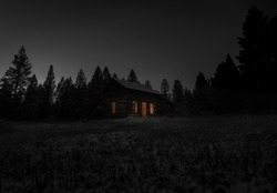 Old shack at night in winter