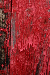 Old shed door detail showing flaking red paint