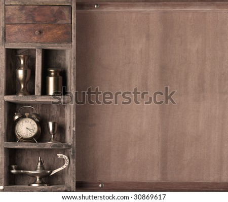 Old shelf with subjects on a wooden background. monochrome
