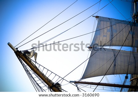 Old ship bow and sail - stock photo