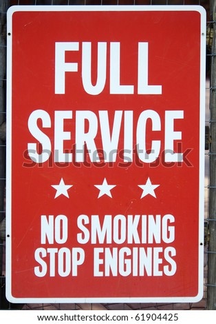 Old sign for full service with no smoking stop engines in smaller lettering - stock photo