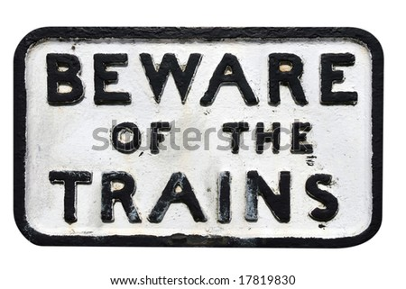 Old sign on railway track warning of trains