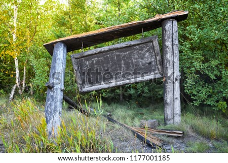 Old sign with the small town Polebridge, Montana, etched into the wood. #1177001185