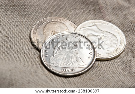 Old silver coins on sack