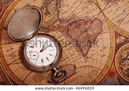 Old silver pocket watch on antique map