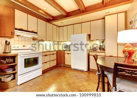 Old simple white and wood kitchen interior with hardwood floor.