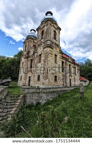 Old Skoky abandoned cathedral with devastated facade on sunny day with clouds Zdjęcia stock ©