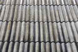 Old slate on the roof of gray color