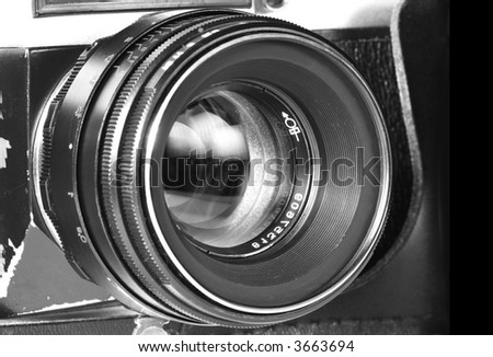Old SLR camera lens shot isolated on a white background