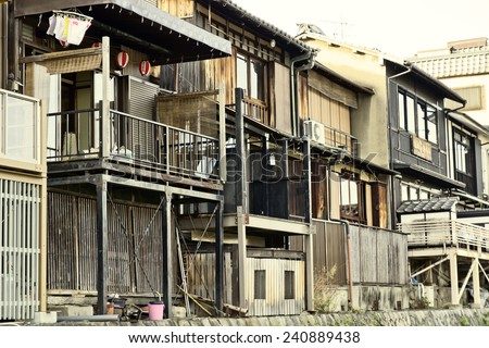 Old small Japanese wood houses on a diagonal vanishing point.