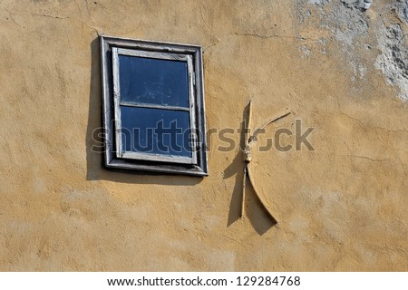 Old small window on the shabby wall in Bulgaria