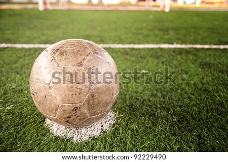 Old soccer ball. Artificial turf.