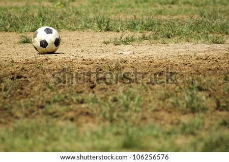 Old Soccer Ball. Poor school soccer field. Charity.
