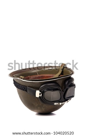 Old soldiers helmet with goggles isolated in white