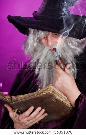Old sorcerer reading a book and smoking a pipe