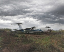 Old Soviet cargo plane IL-76 on the ground in cloudy weather. High quality photo
