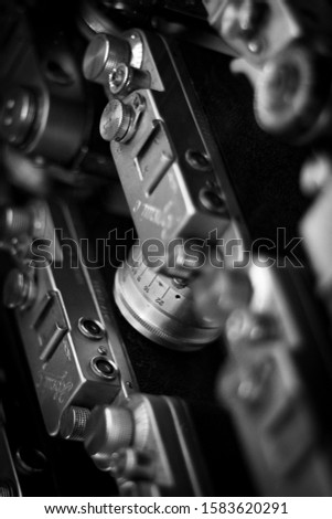 Old Soviet film cameras pattern. Vintage camera closeup background. Retro photo equipment screensaver. Photographic equipment, equipment for photography. Different photo accessories for shooting.