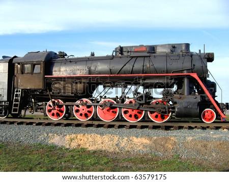 Old Soviet locomotive against the sky.