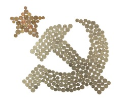 Old Soviet money laid out in the form of a hammer and sickle symbol. The sign of the socialist state. A scattering of metal coins on a white background. Money of the USSR.