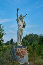 Old Soviet monument of working with the girl in his arms.