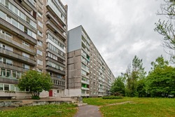 Old soviet residential buildings with a trees around it