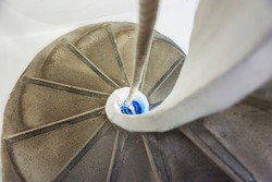 Old Spiral staircase downstairs with rope handrail