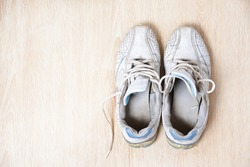 Old sport shoes on wooden background