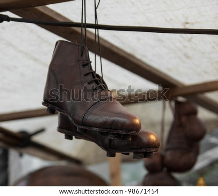 Old sports shoes at a flea market in London - stock photo