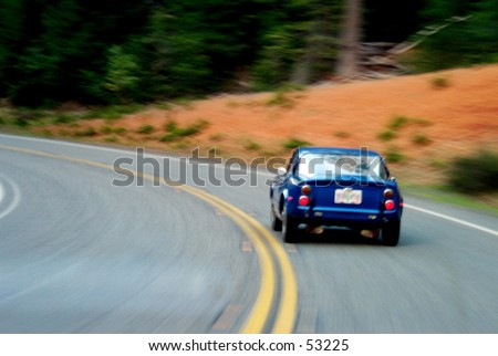 Old sportscar on a curvy road