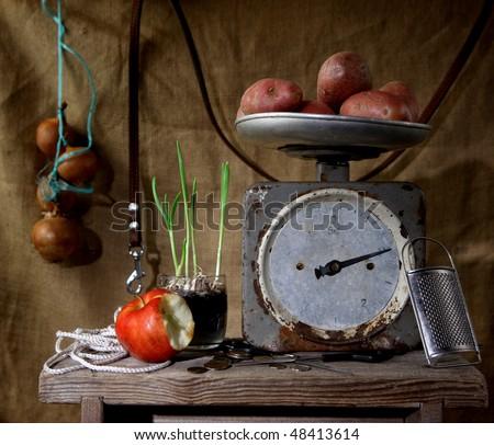 Old spring-balance. One kilogram of potato. Still life.