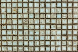 Old square background mosaic, ceramics. Abstract pixels. Ceramic tiles. Texture for facing the walls of the pool, bathroom, kitchen, tiled floor. Red mosaic tile wall. Square mosaic tile