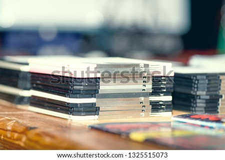 Old stacked floppy disks on the table.