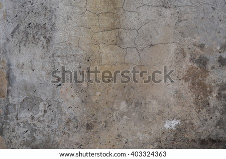 old stained concrete wall texture background. gray color #403324363