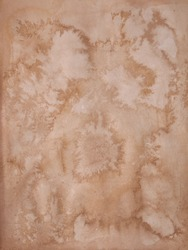 old stained or foxed or moldy paper. grunge background texture.
