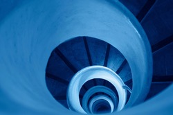 Old stairs in spiral staircase with hand toned in classic blue - color of the year 2020