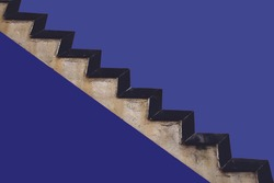 Old stairs on purple building wall