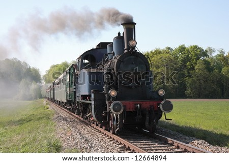 old steam engine powered train approaching