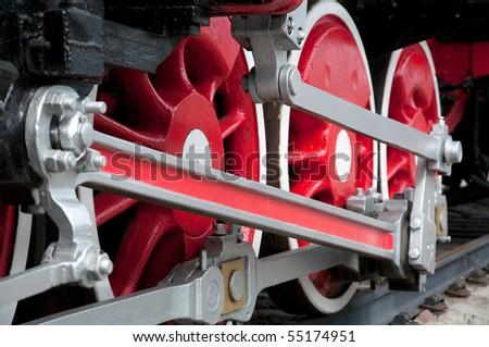 Old steam engine wheels close-up, horizontal