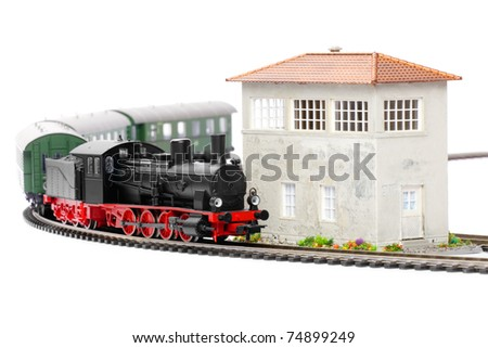 old steam loco model with passenger cars isolated over white background