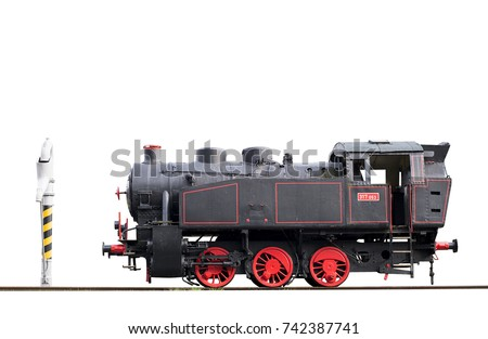 Old steam locomotive and water pump isolated