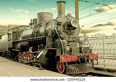 Old steam locomotive at station