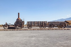 old steam tractor and wagons from 1894 serving the mine road in the death valley for Borate mining.