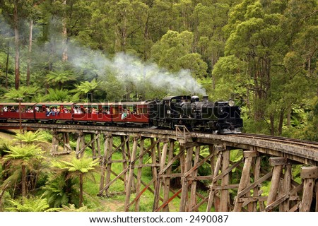 Old steam train crossing a bridge