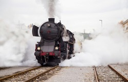 Old Steam train - locomotive is leaving the Railway Station at Nova Gorica, Slovenia, Europe