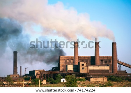Old steel factory. Smoke. Environmental pollution and global warming.