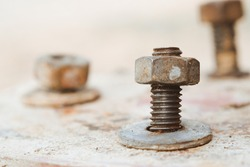 Old steel head bolts or nut with ring and screws rusted close-up with vintage tone.