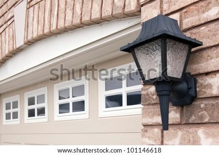 Old stile light lantern on a red brick wall. #101146618