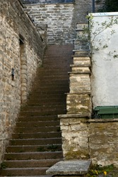 Old stone abandoned staircase in the city. High quality photo